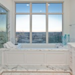 The guest bedroom bathtub is shown here. along with a view of Uptown Dallas