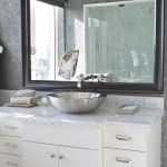 Here's a closer look at the bathroom sink and counter top, along with the bathroom mirror.