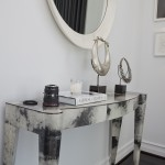 Side table below mirror in master bedroom designed by Ann Sutherland.