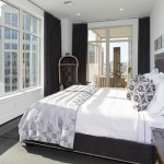 Here's a wide angle view showcasing the master bedroom designed by Ann Sutherland