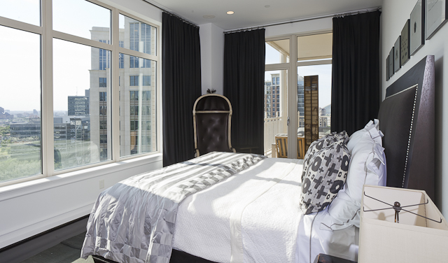 A view from the corner angle of the Ann Sutherland designed master bedroom.
