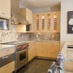 You can see the stainless steel oven and stove, along with the wooden cabinetry here.