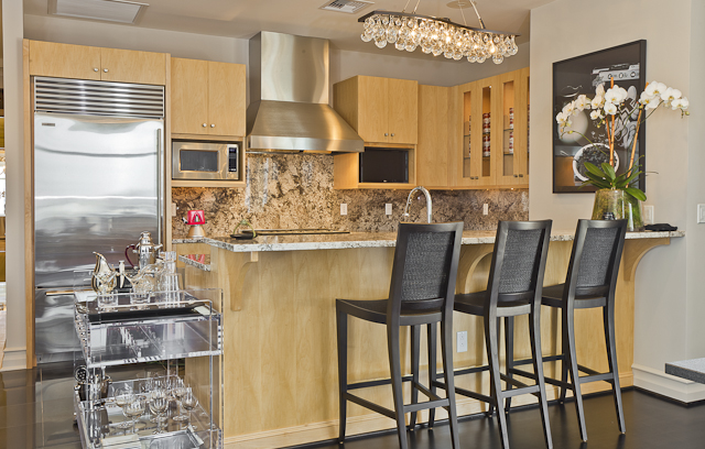 A full view of the kitchen and bar area of the Ann Sutherland Showcase  Residence.