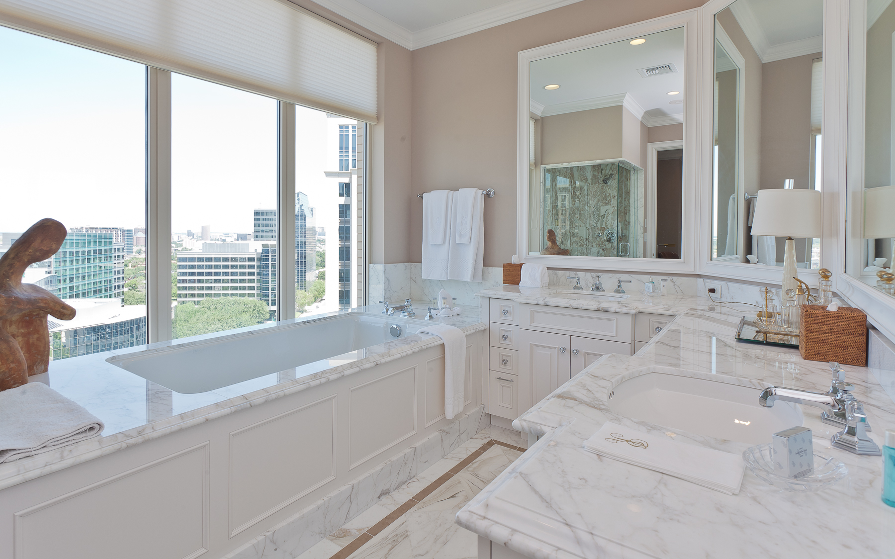 White granite bathroom, with white and sterling silver accents for The Residences Dallas