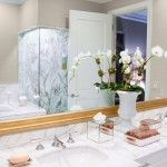 The bathroom of the Laura Hunt Showcase Residence, featuring a beautiful flower centerpiece.