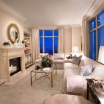 The Living room of the Laura Hunt showcase residence. Featuring exquisite decor and a fireplace