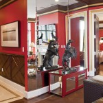 Here's a view of a part of the living room area in the Carleton Varney showcase residence. It features a statue and gorgeous red paint.